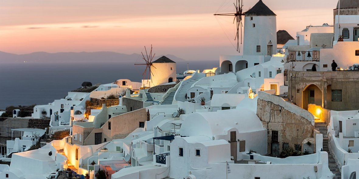 The Greek island ofSantorini isapicturesque archipelago inthe Aegean Sea with white houses and spectacular sunsets 2021